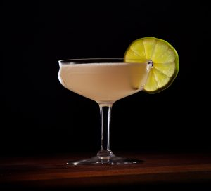Hemingway daiquiri garnished with a lime wheel served in a glass